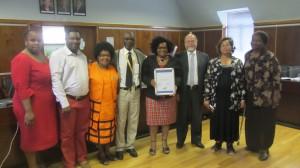 Ndileka receiving Mayor's Civic Award, February 2013